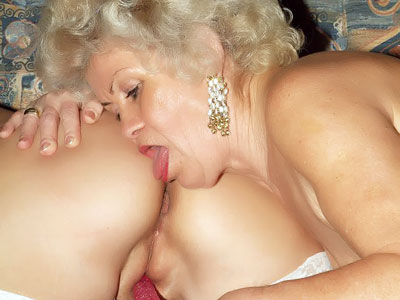 Warm Aged Femmes Toying With A Fake Penis